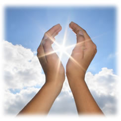 Photograph of hands reaching up to the sun